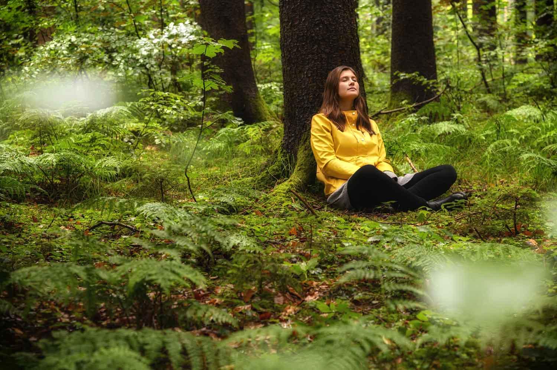 Woman sitting under a tree